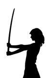 Ragazza con il katana nella siluetta dello studio Immagine Stock