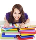 Ragazza con il libro di colore della pila. Immagine Stock Libera da Diritti