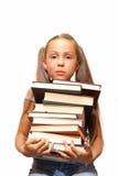 Ragazza con il mucchio dei libri Fotografia Stock