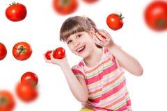 Ragazza con il pomodoro fotografia stock