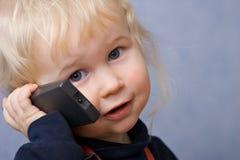 Ragazza con il telefono Fotografia Stock