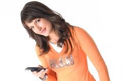 Ragazza con il telefono mobile Immagine Stock