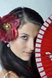 Ragazza con il ventilatore Fotografie Stock Libere da Diritti
