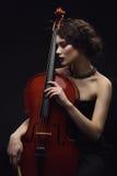 Ragazza con il violoncello Fotografie Stock