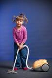 Ragazza con l'aspirapolvere Fotografie Stock Libere da Diritti