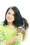 Ragazza con l'capelli-essiccatore fotografia stock libera da diritti