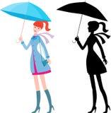 Ragazza con l'ombrello blu Immagini Stock Libere da Diritti