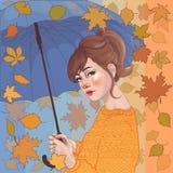 ragazza con l'ombrello, nell'ambito di leaffall Fotografie Stock Libere da Diritti