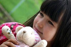 Ragazza con la bambola immagine stock libera da diritti