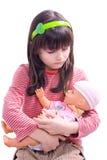 Ragazza con la bambola fotografia stock libera da diritti