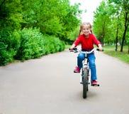 Ragazza con la bicicletta Fotografia Stock