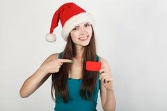 Ragazza con la carta, il cappello di Santa Immagine Stock