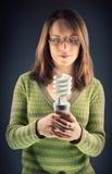 Ragazza con la lampadina di eco Immagini Stock Libere da Diritti