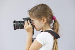 Ragazza con la macchina fotografica Fotografie Stock