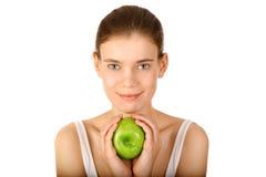 Ragazza con la mela Fotografie Stock Libere da Diritti