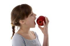 Ragazza con la mela Immagine Stock