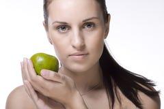 Ragazza con la mela verde Fotografie Stock Libere da Diritti