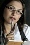 Ragazza con la penna Fotografia Stock