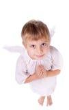 Ragazza con la preghiera delle ali di angelo Immagine Stock