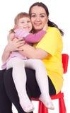 Ragazza con la sua madre grassa Immagine Stock