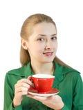 Ragazza con la tazza rossa Fotografie Stock Libere da Diritti