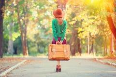 Ragazza con la valigia Fotografia Stock Libera da Diritti