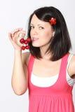 Ragazza con le ciliege Fotografie Stock