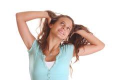 Ragazza con le mani in capelli Fotografia Stock Libera da Diritti