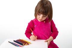 Ragazza con le matite Fotografia Stock