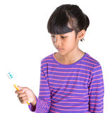 Ragazza con lo spazzolino da denti VII Fotografia Stock