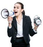Ragazza con un allarme e un megafono Fotografia Stock