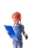 Ragazza con un casco della costruzione Immagine Stock