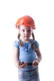 Ragazza con un casco della costruzione Immagini Stock Libere da Diritti