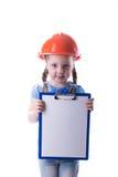 Ragazza con un casco della costruzione Fotografia Stock
