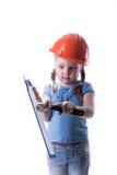 Ragazza con un casco della costruzione Fotografie Stock Libere da Diritti