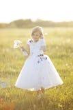 ragazza con un fiore Fotografia Stock Libera da Diritti