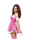 Ragazza con un lollipop in suo vestito da colore rosa e dalla mano Fotografia Stock