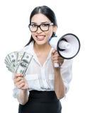 Ragazza con un megafono ed i soldi Fotografia Stock
