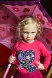 Ragazza con un ombrello Fotografia Stock