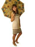 Ragazza con un ombrello isolato su bianco Immagini Stock