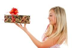 Ragazza con un presente Fotografia Stock