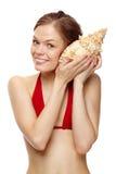 Ragazza con un seashell Fotografia Stock