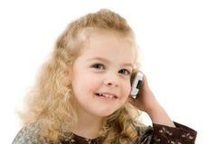 Ragazza con un telefono immagini stock libere da diritti