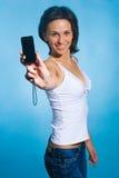 Ragazza con un telefono Fotografie Stock Libere da Diritti