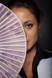 Ragazza con un ventilatore Fotografia Stock Libera da Diritti