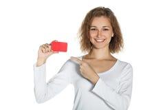 Ragazza con una carta. Fotografia Stock
