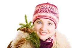 Ragazza con una filiale dell'albero della pelliccia Fotografia Stock Libera da Diritti