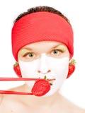 Ragazza con una mascherina di fase Fotografia Stock