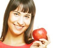 Ragazza con una mela rossa a disposizione Immagine Stock