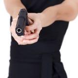 Ragazza con una pistola. immagini stock